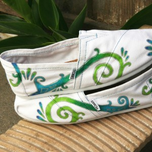 Custom, hand painted Color Swirl TOMS shoes featuring a green to blue ombre of a swirl design outlined in silver.