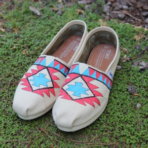 Custom, hand painted Tribal Pattern TOMS shoes featuring a turquoise and scarlet geometric pattern.